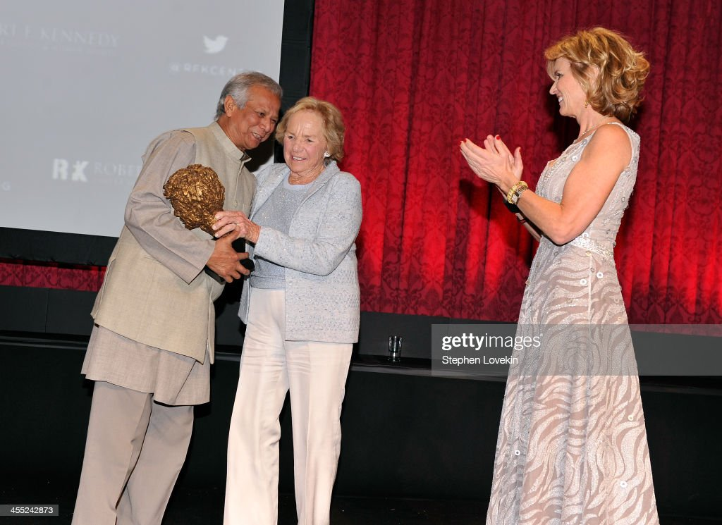 RFK Ripple of Hope Award Honoree <a gi-track='captionPersonalityLinkClicked' href=/galleries/search?phrase=Muhammad+Yunus&family=editorial&specificpeople=634405 ng-click='$event.stopPropagation()'>Muhammad Yunus</a> accepts award onstage with <a gi-track='captionPersonalityLinkClicked' href=/galleries/search?phrase=Ethel+Kennedy&family=editorial&specificpeople=211589 ng-click='$event.stopPropagation()'>Ethel Kennedy</a> and <a gi-track='captionPersonalityLinkClicked' href=/galleries/search?phrase=Kerry+Kennedy&family=editorial&specificpeople=632610 ng-click='$event.stopPropagation()'>Kerry Kennedy</a> at Robert F. Kennedy Center For Justice And Human Rights 2013 Ripple Of Hope Awards Dinner at New York Hilton Midtown on December 11, 2013 in New York City.