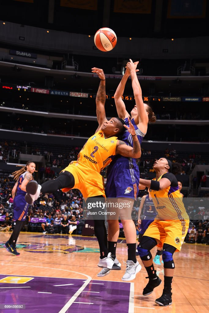 Riquana Williams #2 of the Los Angeles Sparks jumps for the rebound against the Phoenix Mercury on June 18, 2017 at STAPLES Center in Los Angeles, California.