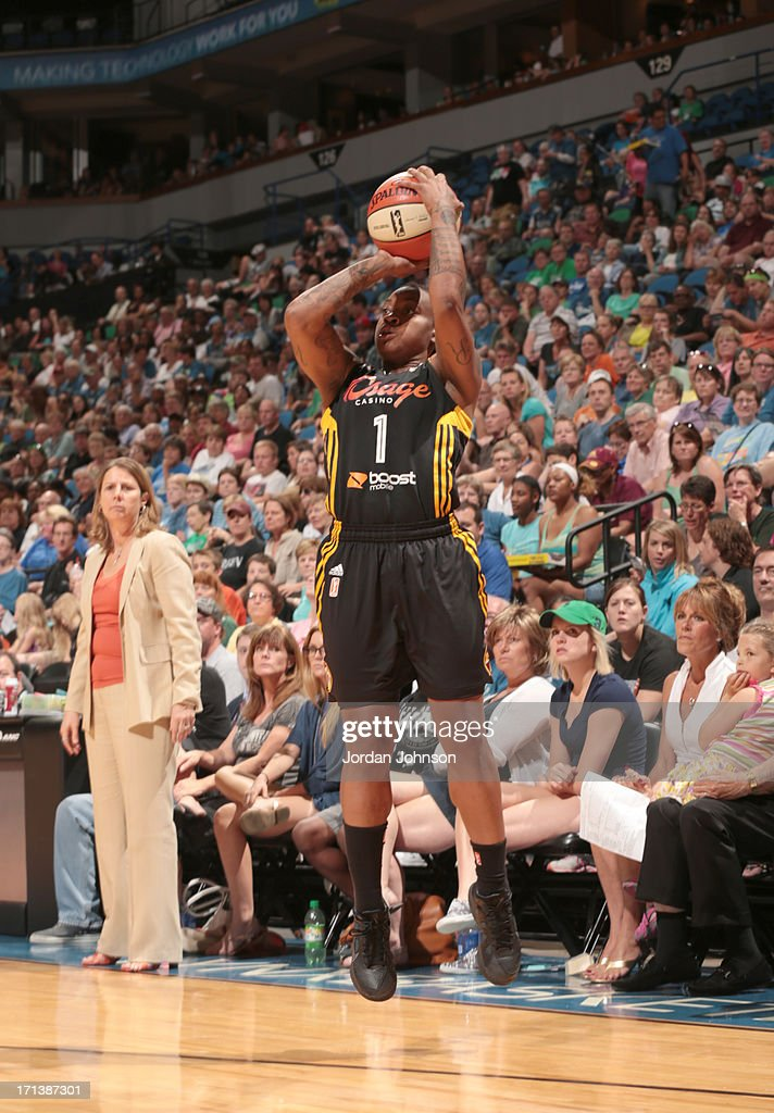 Riquna Williams #1 of the the Tulsa Shock shoots against the Minnesota Lynx during the WNBA game on June 23, 2013 at Target Center in Minneapolis, Minnesota.
