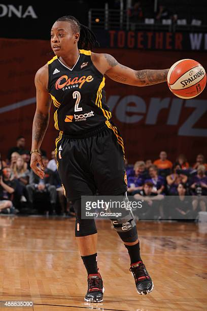 Riquna Williams of the Tulsa Shock dribbles the ball against the Phoenix Mercury during Game One of the WNBA Western Conference Semifinals on...