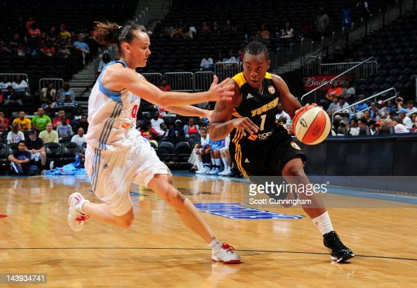 Riquna Williams of the Tulsa Shock drives against Coco Miller of the Atlanta Dream at Philips Arena on May 4 2012 in Atlanta Georgia NOTE TO USER...