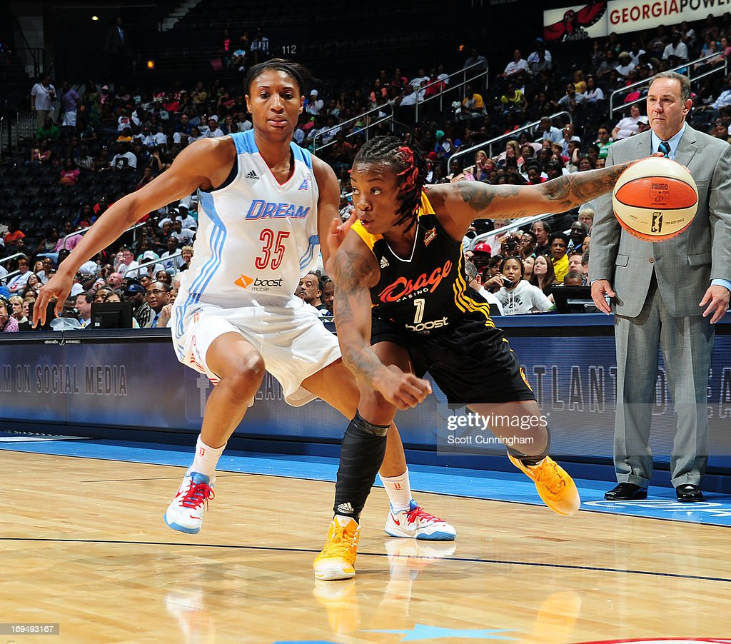 Riquna Williams #1 of the Tulsa Shock drives against the Atlanta Dream at Philips Arena on May 25, 2013 in Atlanta, Georgia.