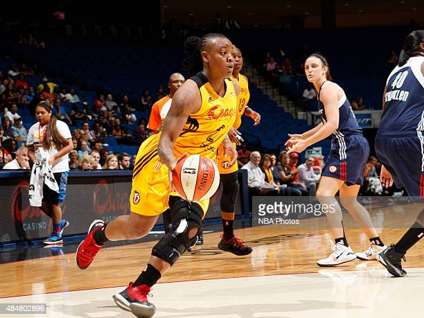 Riquna Williams of the Tulsa Shock drives to the basket against the Connecticut Sun on August 21 2015 at the BOK Center in Tulsa Oklahoma NOTE TO...