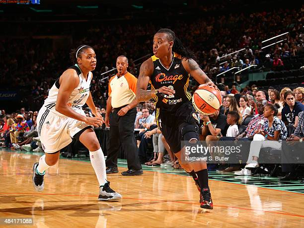 Riquna Williams of the Tulsa Shock handles the ball against Tanisha Wright of the New York Liberty on August 15 2015 at Madison Square Garden New...