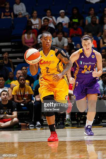Riquna Williams of the Tulsa Shock handles the ball against the Los Angeles Sparks in a WNBA game on July 11 2015 at the BOK Center in Tulsa Oklahoma...
