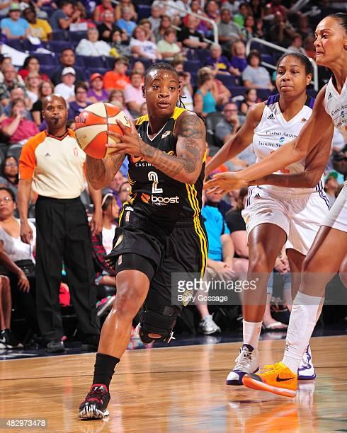 Riquna Williams of the Tulsa Shock handles the ball against the Phoenix Mercury on August 4 2015 at Talking Stick Resort Arena in Phoenix Arizona...