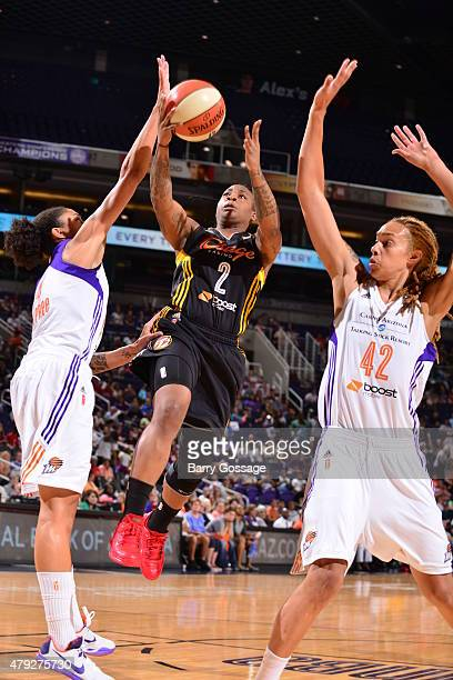 Riquna Williams of the Tulsa Shock shoots against Candice Dupree and Brittney Griner of the Phoenix Mercury on July 2 2015 at Talking Stick Resort...