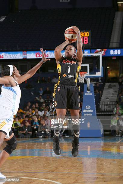 Riquna Williams of the Tulsa Shock shoots over Swin Cash of the Chicago Sky during the game on June 2 2013 at the Allstate Arena in Rosemont Illinois...