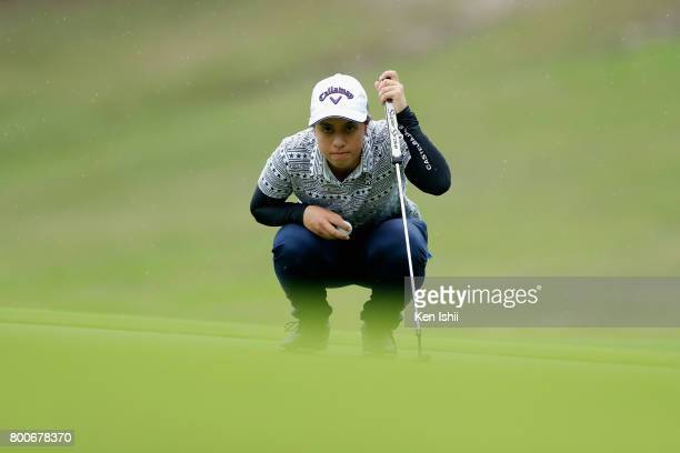 Ririna Staiano of Japan lines up for a putt on the 9th green during the final round of the Yupiteru The Shizuoka Shimbun SBS Ladies at the Shizuoka...