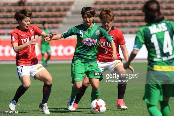 Risa Ikadai of Urawa Red Diamonds Ladies and Rin Sumida of NTV Beleza compete for the ball during the Nadeshiko League match between Diamonds Ladies...