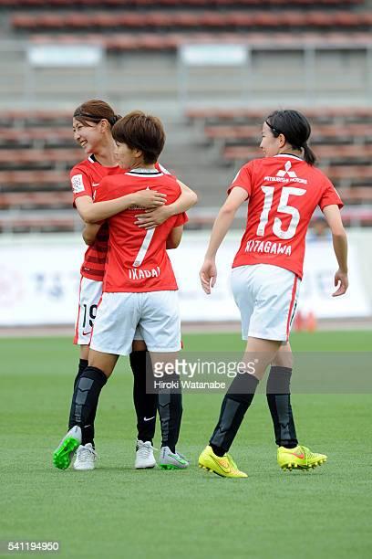 Risa Ikadai of Urawa Reds celebrates scoring the opening goal with her team mates Yuzuho Shiokoshi and Hikaru Kitagawa during the Nadeshiko League...