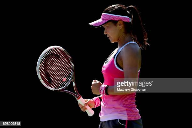 Risa Ozaki of Japan celebrates against Julia Boserup during the Miami Open at the Crandon Park Tennis Center on March 21 2017 in Key Biscayne Florida