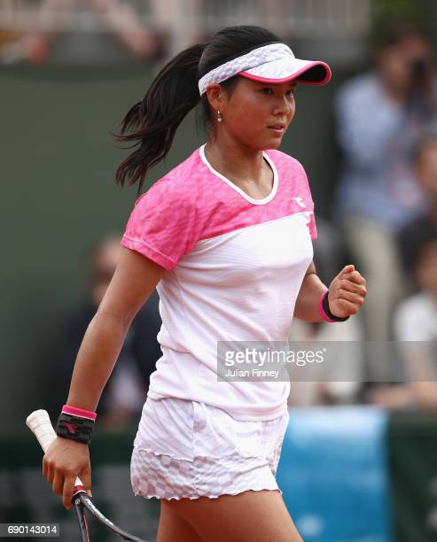 Risa Ozaki of Japan celebrates during the ladies singles first round match against Eugenie Bouchard of Canada on day three of the 2017 French Open at...