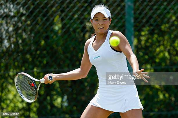 Risa Ozaki of Japan in action during her first round qualifying match against Indy De Vroome of the Netherlands on day two of the Wimbledon...