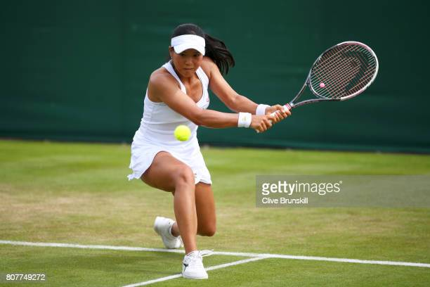 Risa Ozaki of Japan plays a backhand during the Ladies Singles first round match against Denisa Allertova of the Czech Republic on day two of the...