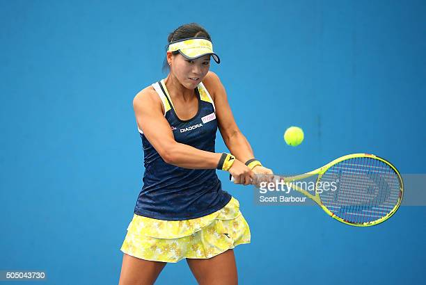 Risa Ozaki of Japan plays a backhand in her match against Maryna Zanevska of Ukraine during round two of 2016 Australian Open Qualifying at Melbourne...