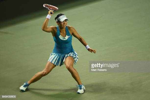Risa Ozaki of Japan plays a forehand against Shelby Rogers of the USA during day two of the Toray Pan Pacific Open Tennis At Ariake Coliseum on...