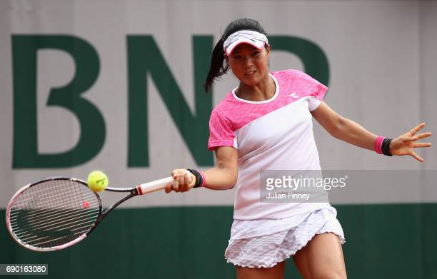 Risa Ozaki of Japan plays a forehand during the ladies singles first round match against Eugenie Bouchard of Canada on day three of the 2017 French...