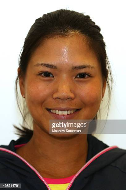 Risa Ozaki of Japan poses during previews ahead of the French Open at Roland Garros on May 23 2014 in Paris France