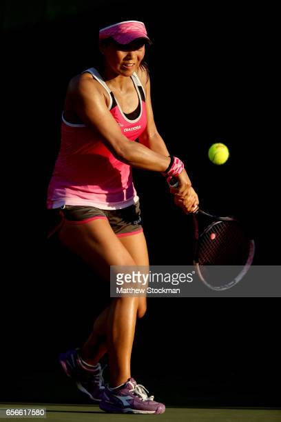Risa Ozaki of Japan returns a shot to Louis Chirico during the Miami Open at the Crandon Park Tennis Center on March 22 2017 in Key Biscayne Florida