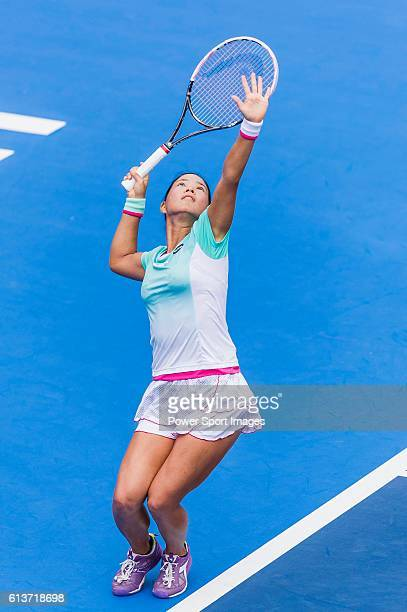Risa Ozaki of Japan serves against Venus Williams of USA during their Singles Round 1 match of the Prudential Hong Kong Open at Victoria Park Stadium...