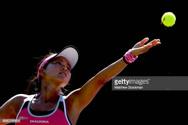 Risa Ozaki of Japan serves to Julia Boserup during the Miami Open at the Crandon Park Tennis Center on March 21 2017 in Key Biscayne Florida