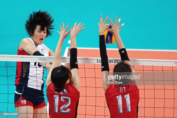 Risa Shinnabe and Ai Otomo of Japan defend the spike of HeeJin Kim of Korea during the Women's Volleyball bronze medal match on Day 15 of the London...