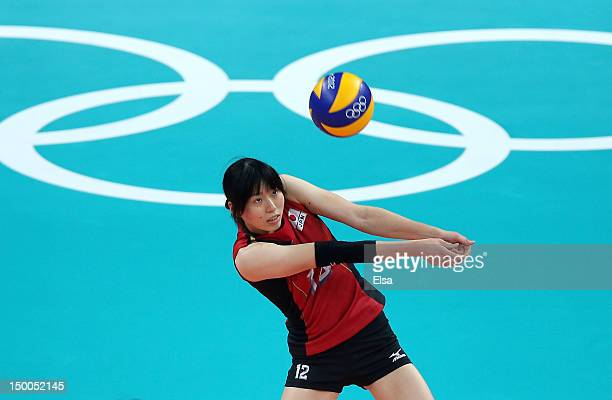 Risa Shinnabe of Japan passes the ball in the first set against Brazil during the Women's Volleyball semifinal match on Day 13 of the London 2012...