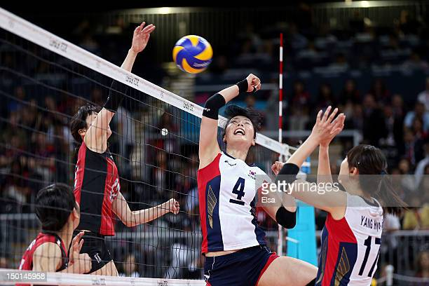 Risa Shinnabe of Japan scores a point against SaNee Kim of Korea during the Women's Volleyball on Day 15 of the London 2012 Olympic Games at Earls...