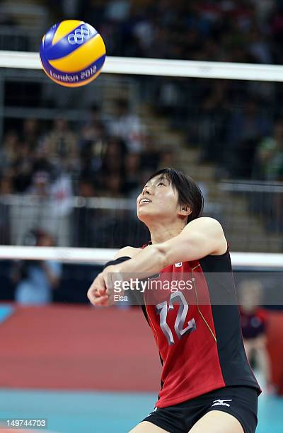 Risa Shinnabe of Japan sends the ball over the net in the third set against Russia during Women's Volleyball on Day 7 of the London 2012 Olympic...