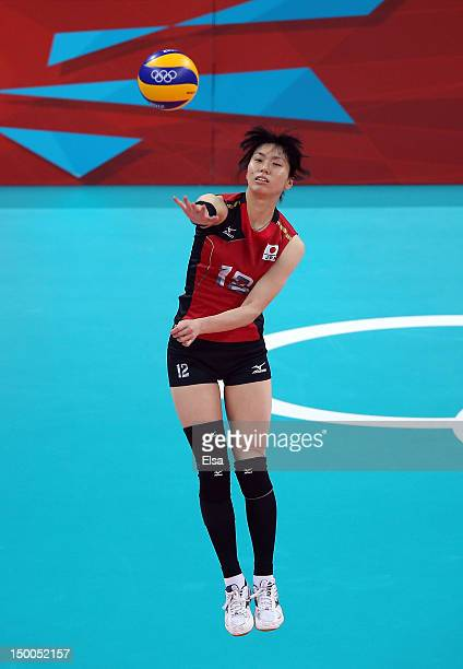 Risa Shinnabe of Japan serves the ball in the first set against Brazil during the Women's Volleyball semifinal match on Day 13 of the London 2012...