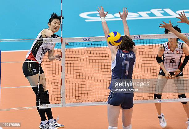 Risa Shinnabe of Japan spikes the ball during day five of the FIVB World Grand Prix Sapporo 2013 match between USA and Japan at Hokkaido Prefectural...
