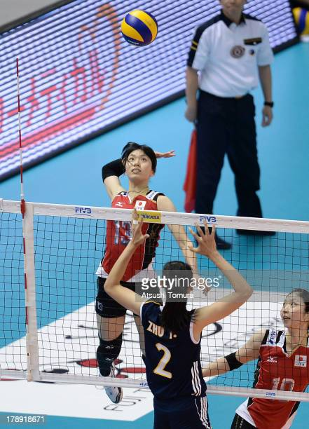 Risa Shinnabe of Japan spikes the ball during day four of the FIVB World Grand Prix Sapporo 2013 match between Japan and China at Hokkaido...
