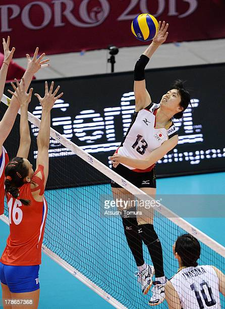 Risa Shinnabe of Japan spikes the ball during day three of the FIVB World Grand Prix Sapporo 2013 match between Serbia and Japan at Hokkaido...