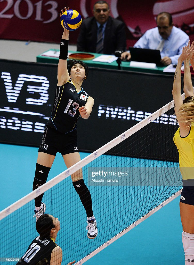 <a gi-track='captionPersonalityLinkClicked' href=/galleries/search?phrase=Risa+Shinnabe&family=editorial&specificpeople=8641931 ng-click='$event.stopPropagation()'>Risa Shinnabe</a> of Japan spikes the ball during day two of the FIVB World Grand Prix Sapporo 2013 match between Japan and Brazil at Hokkaido Prefectural Sports Center on August 29, 2013 in Sapporo, Hokkaido, Japan.