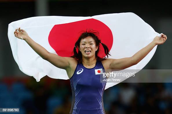 Risako Kawai of Japan celebrates after defeating Maryia Mamashuk of Belarus during the Women's Freestyle 63 kg Gold medal match on Day 13 of the Rio...