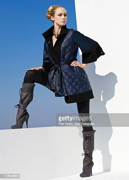 Rise above the rest in this distinctive black wooledged navy quilted kimono jacket from Binetti available by special order from SHE Boutique its...