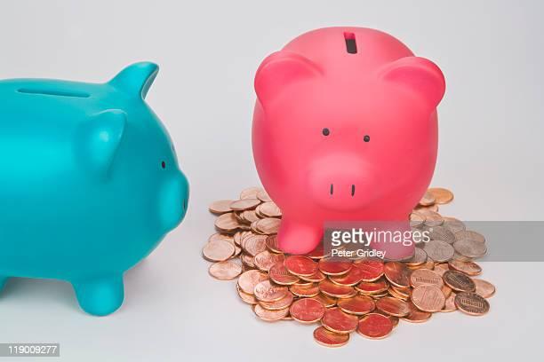 Rish piggy bank , poor piggy bank