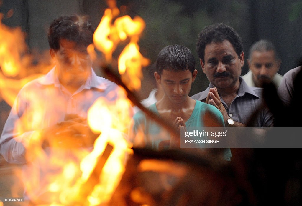 Rishabh the son of A K Sharma a school teacher who was killed in bomb blast outside Delhi high court prays during his fathers cremation in New Delhi...