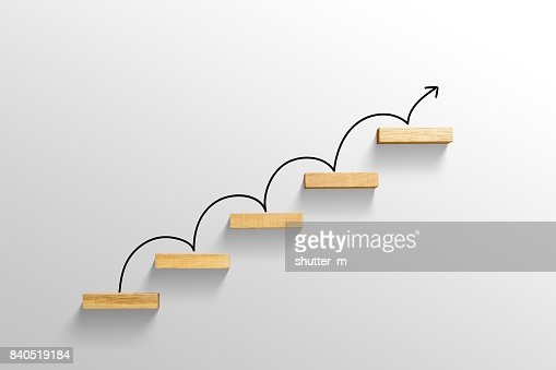 rising arrow on staircase, increasing business : Stock Photo