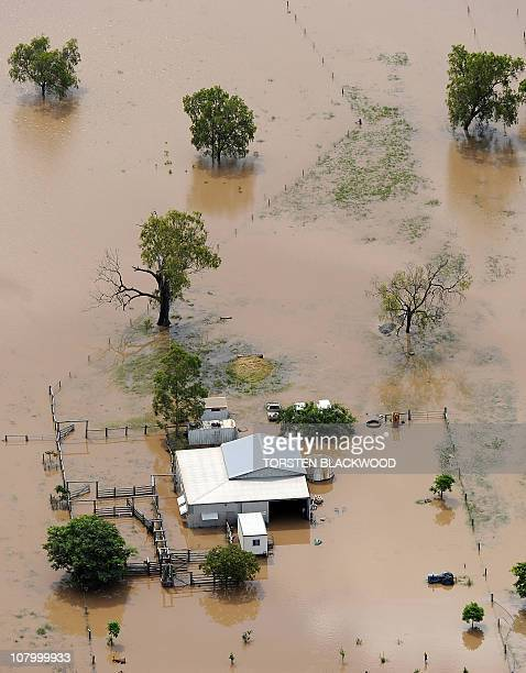 Rising flood waters inundate another farmhouse after the swollen Fitzroy River broke its banks and flooded the city of Rockhampton and surrounding...