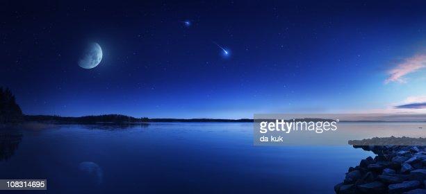 Rising moon over lake