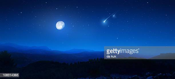 Rising moon over mountains