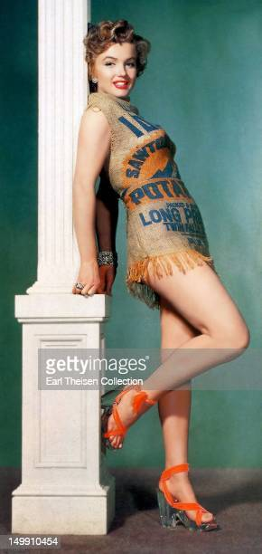 Rising star Marilyn Monroe poses for a portrait in a dress made out of an Idaho potato sack in 1951 in Los Angeles California