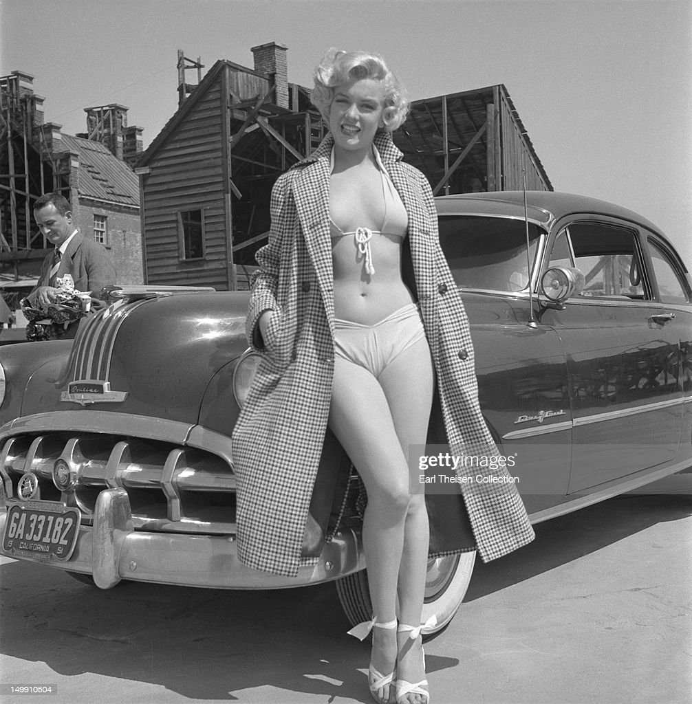 Rising star <a gi-track='captionPersonalityLinkClicked' href=/galleries/search?phrase=Marilyn+Monroe&family=editorial&specificpeople=70021 ng-click='$event.stopPropagation()'>Marilyn Monroe</a> poses for a portrait next to a 1950 Pontiac Chieftain on the backlot of 20th Century-Fox in 1951 in Los Angeles, California.