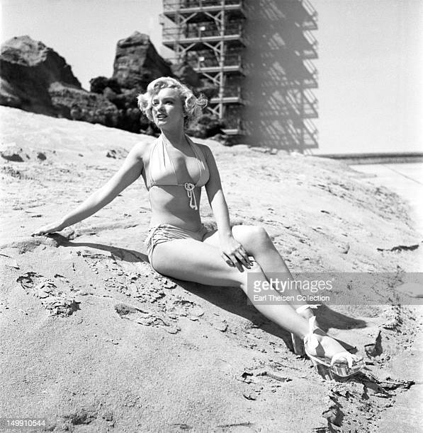 Rising star Marilyn Monroe poses for a portrait on the backlot of 20th CenturyFox in 1951 in Los Angeles California