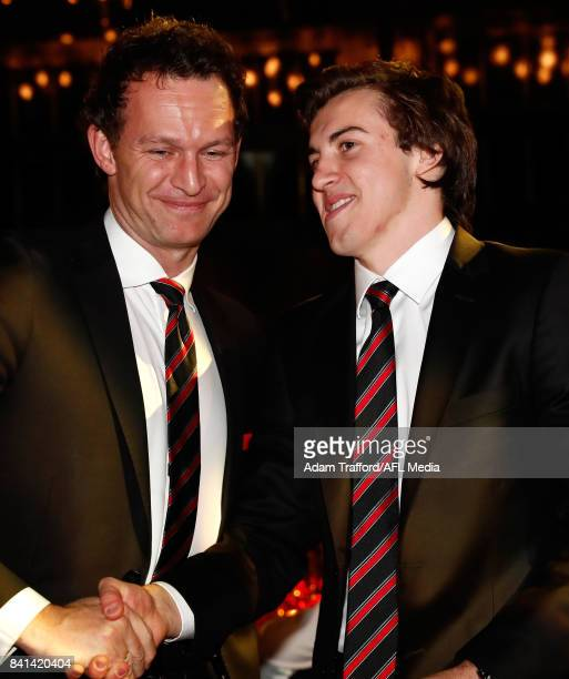 Rising star winner Andrew McGrath of the Bombers is congratulated Xavier Campbell CEO of the Bombers during the 2017 NAB AFL Rising Star awards at...
