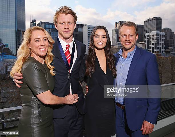 Rising Star winner Callum Mills of the Swans poses with girlfriend Tiffany Browne and parents Simone Mills and Darren Mills during the 2016 AFL...