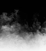 Rising steam on black background