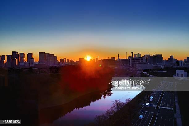 Rising sun and Tokyo skyline